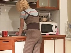 Horny Alice bangs a dildo stuck to her cabinet doors